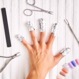Soak your nails in acetone the use of cotton balls and aluminum foil
