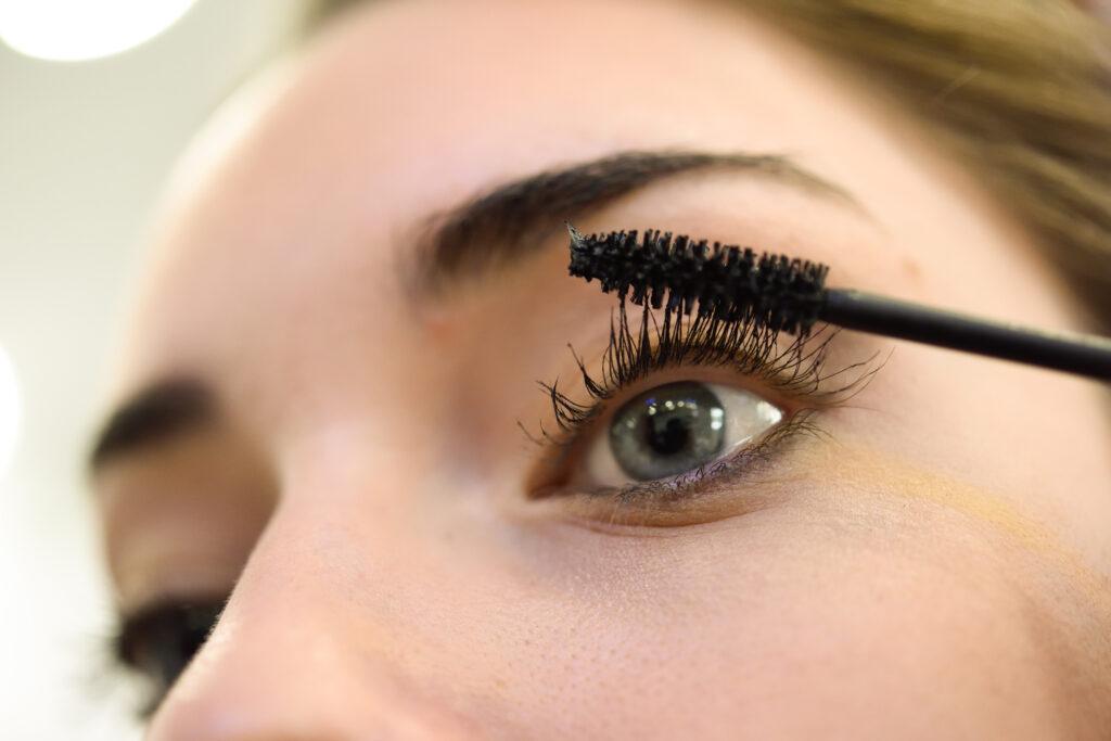 Makeup. Make-up. Applying Mascara. Long Eyelashes and blue eyes